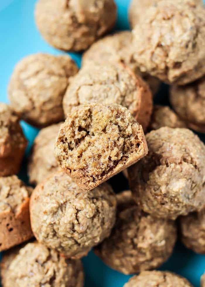 vegan gluten free mini banana muffins with blue background