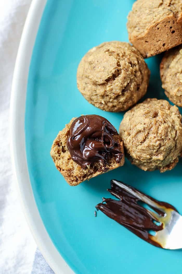 vegan gluten free mini banana muffins on blue plate with chocolate hazelnut spread