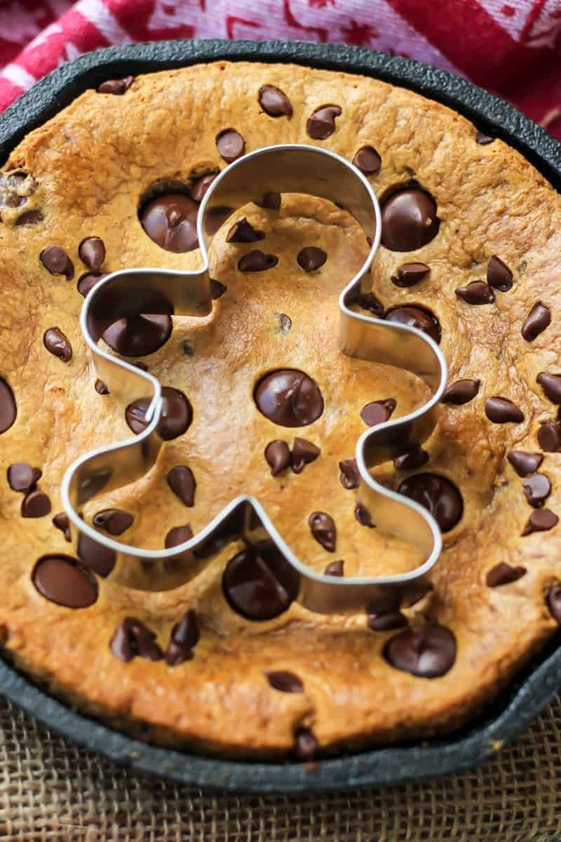 Paleo Gingerbread Chocolate Chip Skillet Cookie with gingerbread cookie cutter