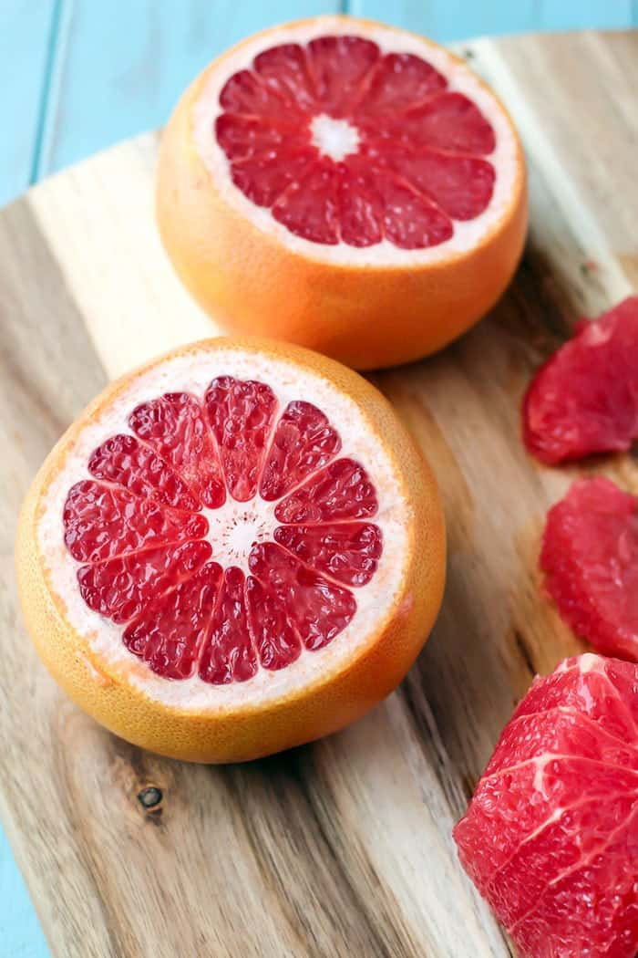 Texas red grapefruit cut on cutting board