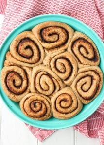 Vegan Orange Cardamom Cinnamon Rolls using sprouted spelt flour! These rolls are actually fluffy!!