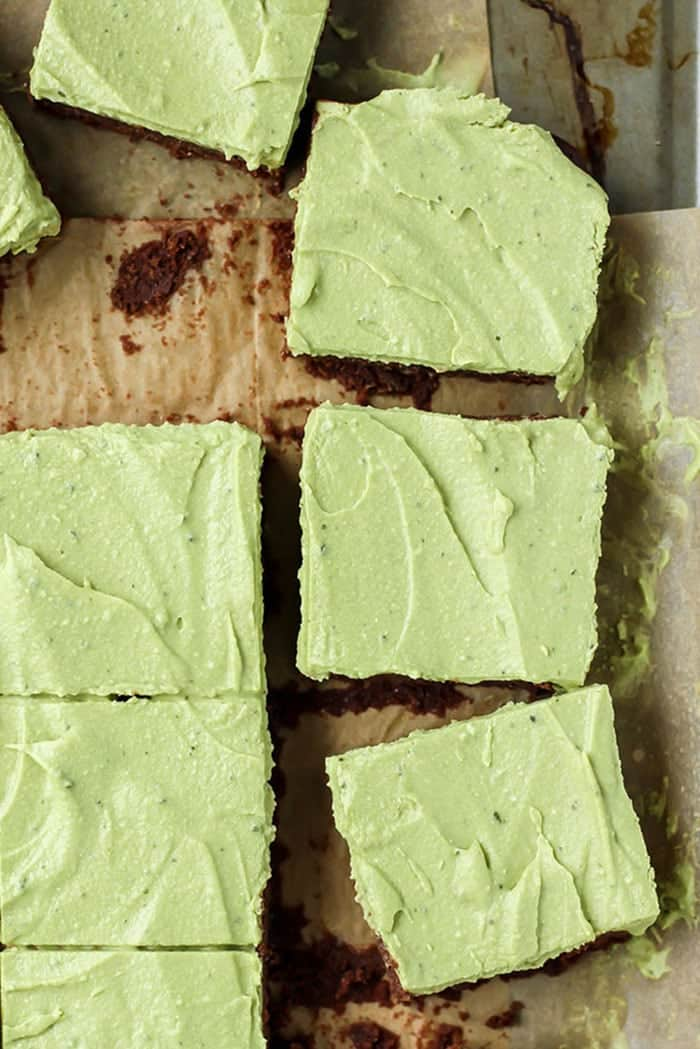 Grain-free, fudgy flourless brownies with a mint matcha frosting on baking sheet