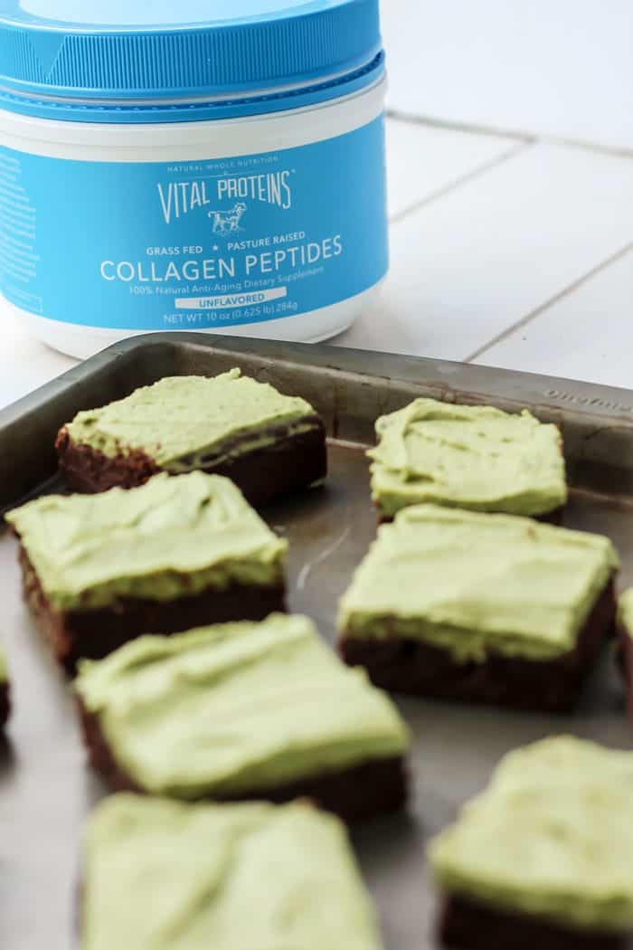 Brownies with matcha frosting and collagen pepties on cookie sheet