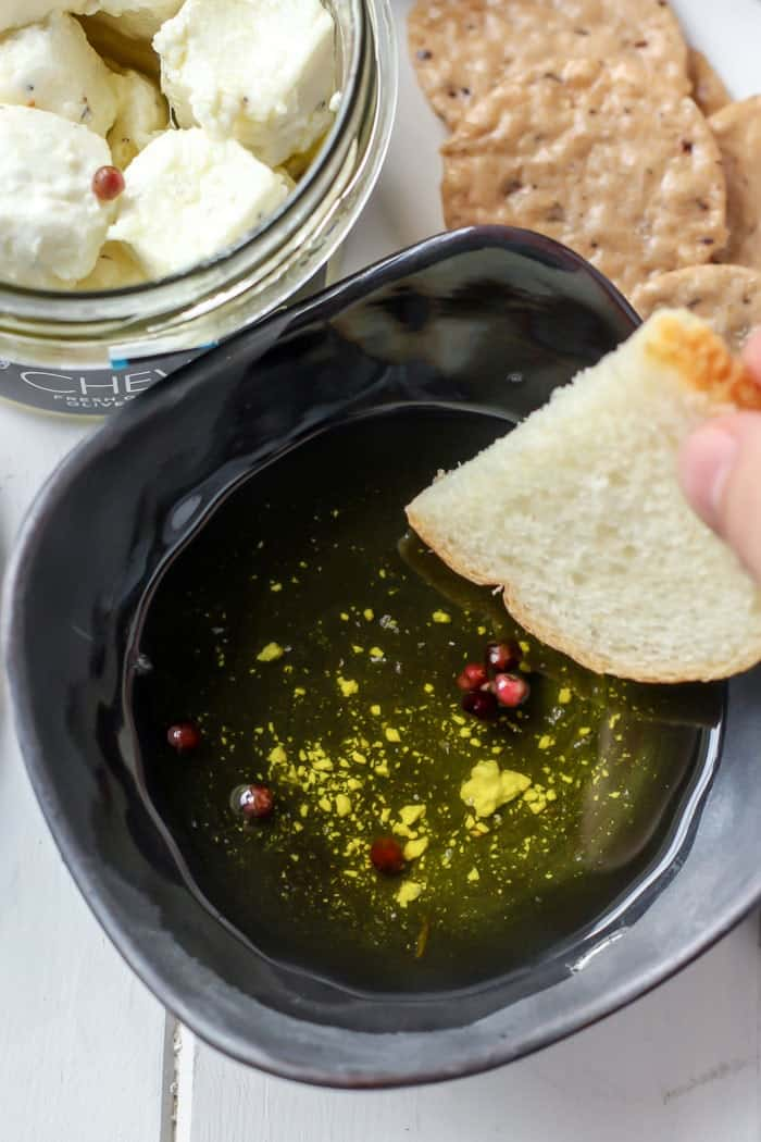bread and olive oil dip with chevoo goat cheese