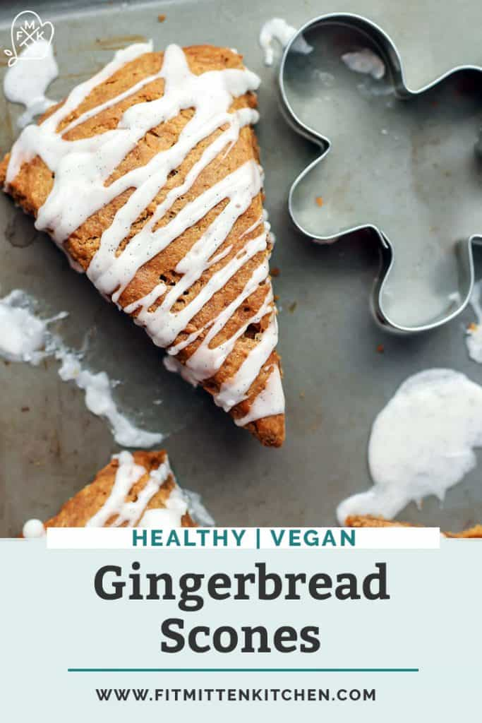 vegan gingerbread scones with vanilla bean glaze on baking sheet with cookie cutter with text overlay
