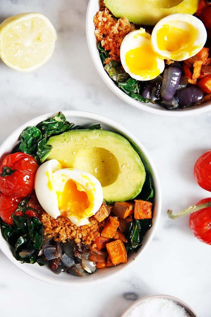 Chorizo Breakfast Bowls with hard boiled eggs avocados and lemon on marble