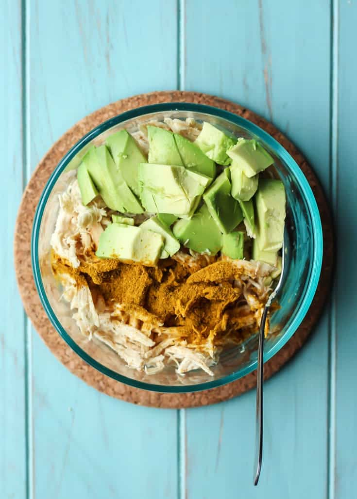 Curried Avocado Chicken Salad Recipe in clear bowl