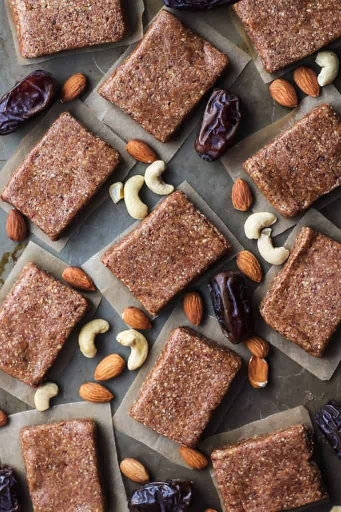 homemade protein bars with dates, cashews, almonds on baking sheet