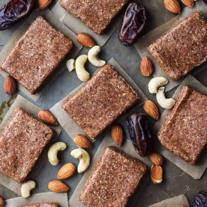 4 ingredient protein bars with cashews, dates and almonds on parchment paper