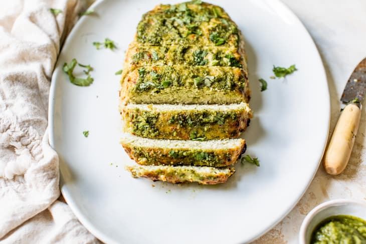 sliced turkey meatloaf on plate with green pesto