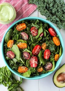 Simple Kale Spinach Salad with a creamy avocado green goddess dressing! Whole30 - Paleo - Vegan
