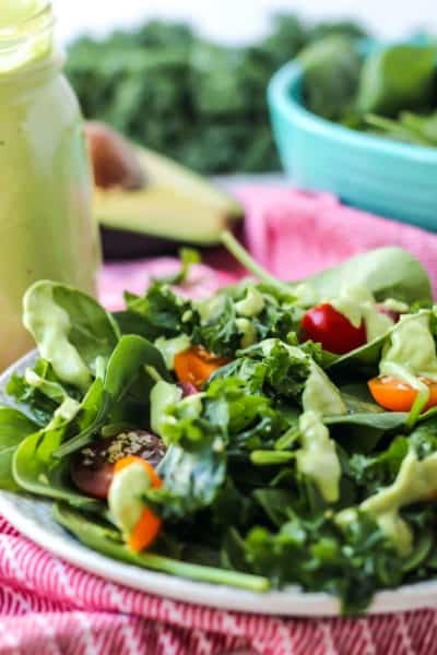 Simple Kale Spinach Salad with Avocado Green Goddess Dressing