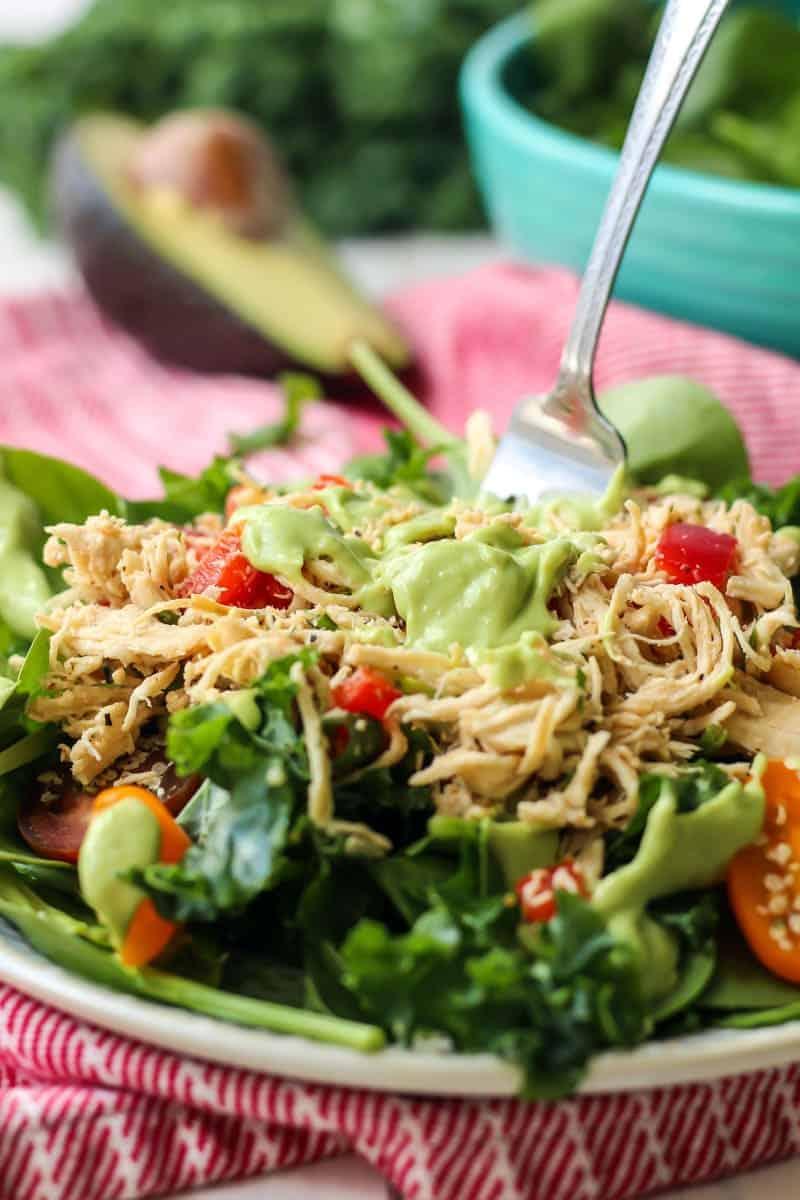 green goddess salad dressing on kale salad with shredded chicken