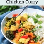 Thai coconut chicken curry with cauliflower rice and cilantro in white bowl with text overlay