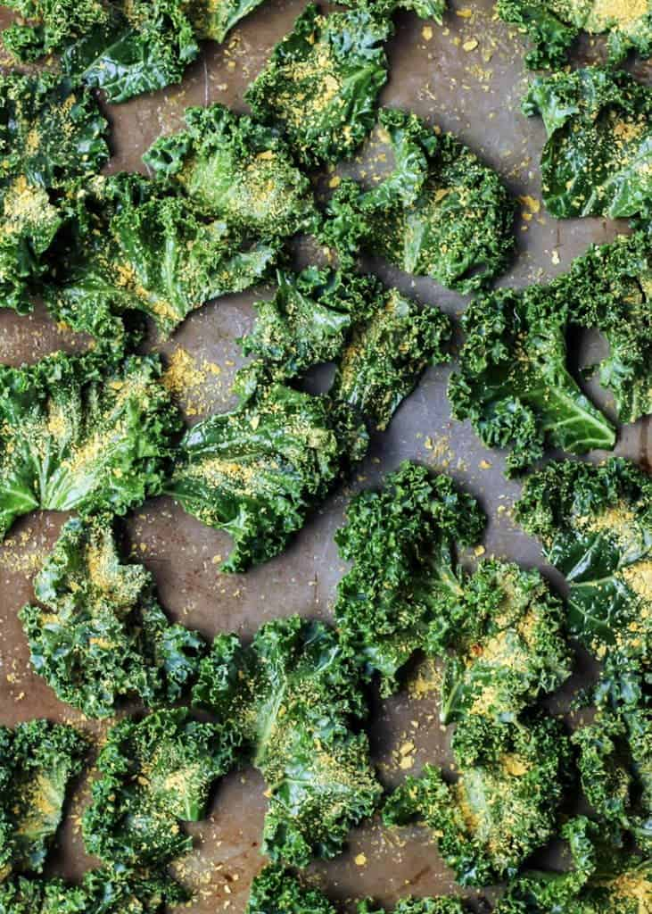 Simple staple seasonsing and nutritional yeast make the BEST kale chips! (vegan, paleo and whole30!)