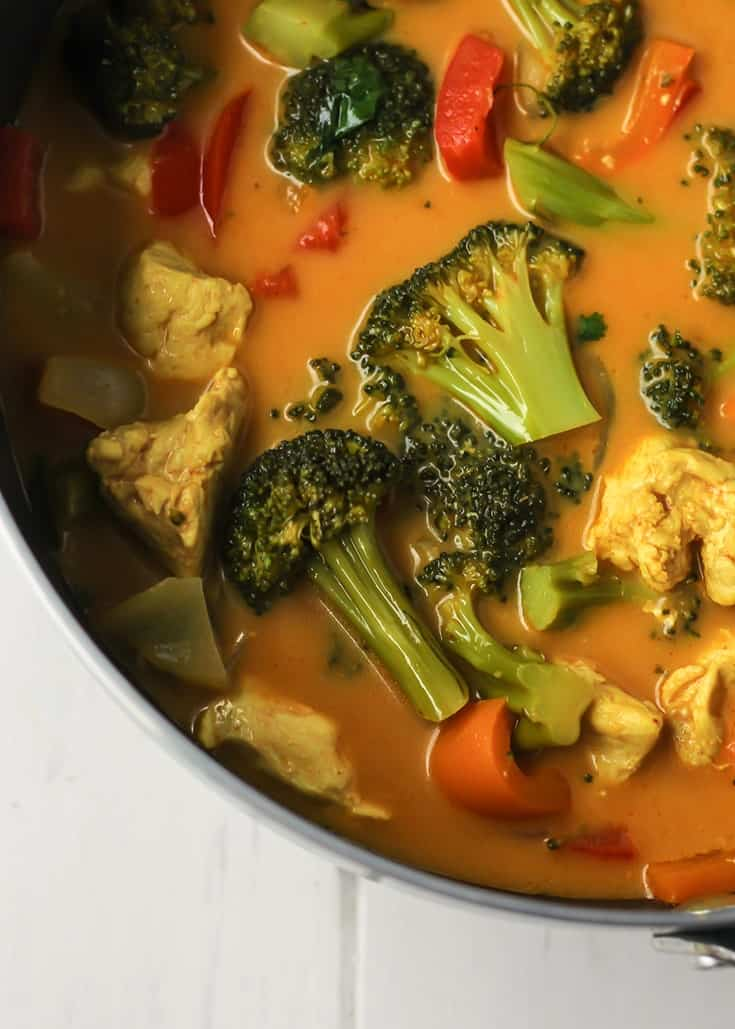 Thai Coconut Chicken Curry in pot with broccoli, bell peppers, onion