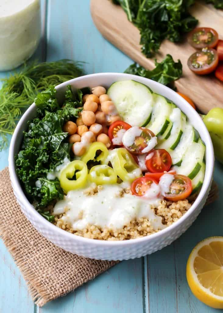 Greek Power Bowl with Tzatziki Dressing in bowl with burlap and lemon