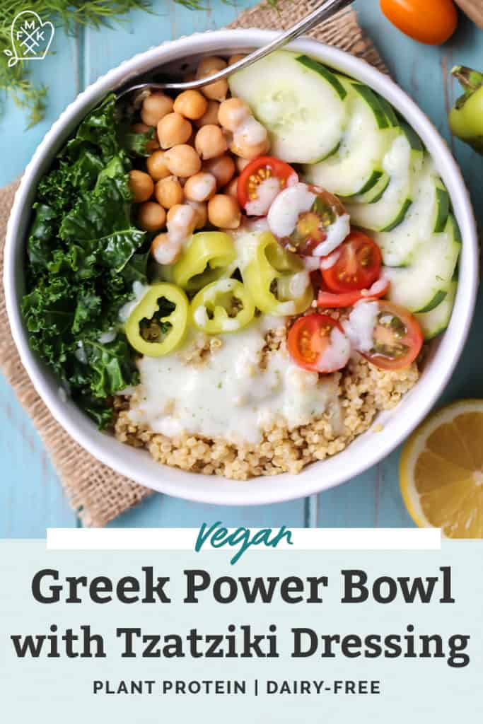 Greek Power Bowl with quinoa pepper cucumbers chickpeas dill lemon tomatoes kale in white bowl with burlap