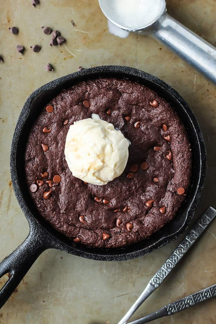 Skillet Brownie with vanilla ice cream scoop and chocolate chips