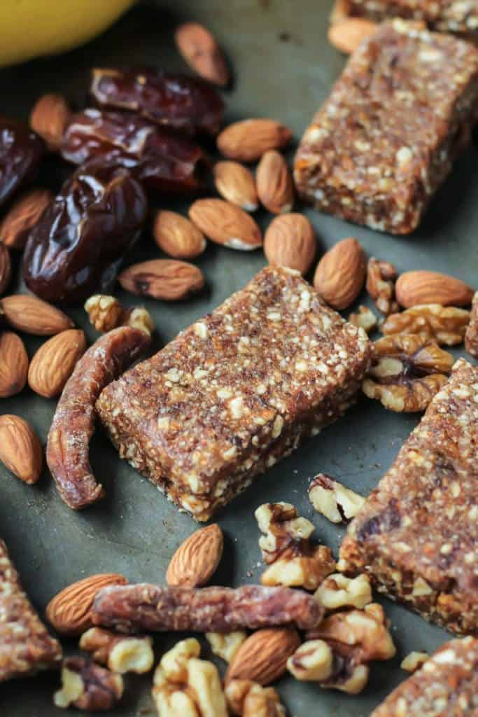 squares of banana date nut bars with dried fruit and nuts