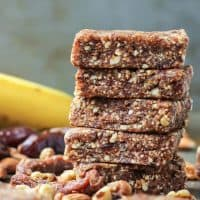 stack of banana bread energy bars with dried fruit, nuts, and banana