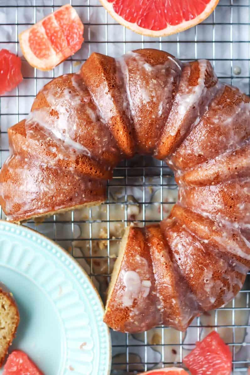 grapefruit greek yogurt bundt cake with slice taken out on cooling rack