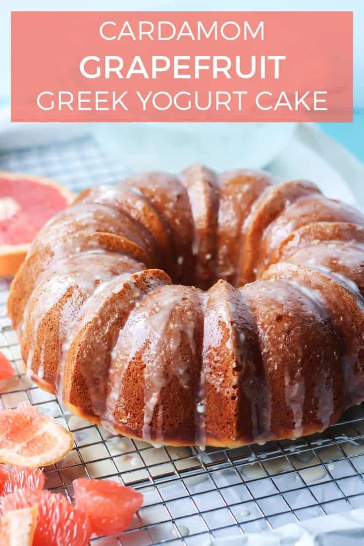 cardamom grapefruit greek yogurt bundt cake on drying rack with grapefuit pieces