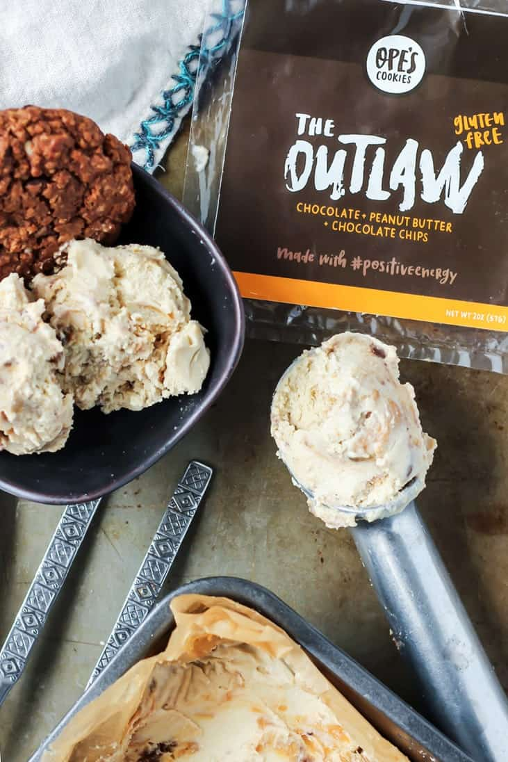 Vegan Peanut Butter Swirl Ice Cream in ice cream scoop with outlaw cookie crumbles