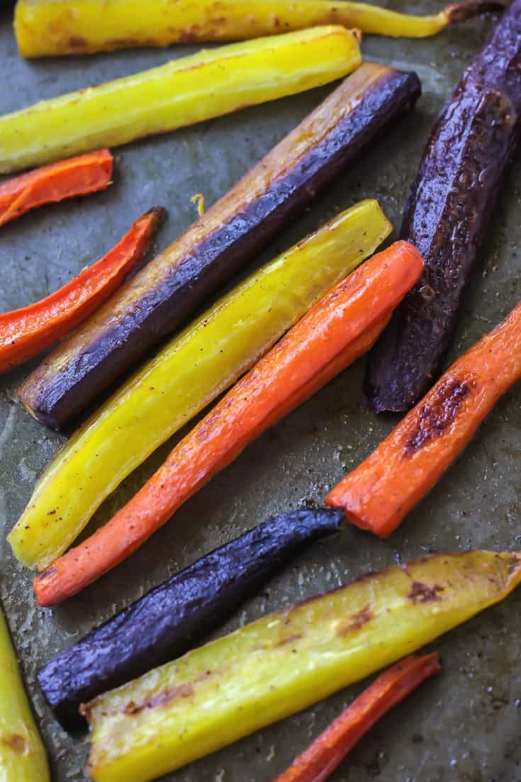 Roasted Rainbow Carrots with an easy tahini ginger sauce! Vegan, paleo, and even Whole30