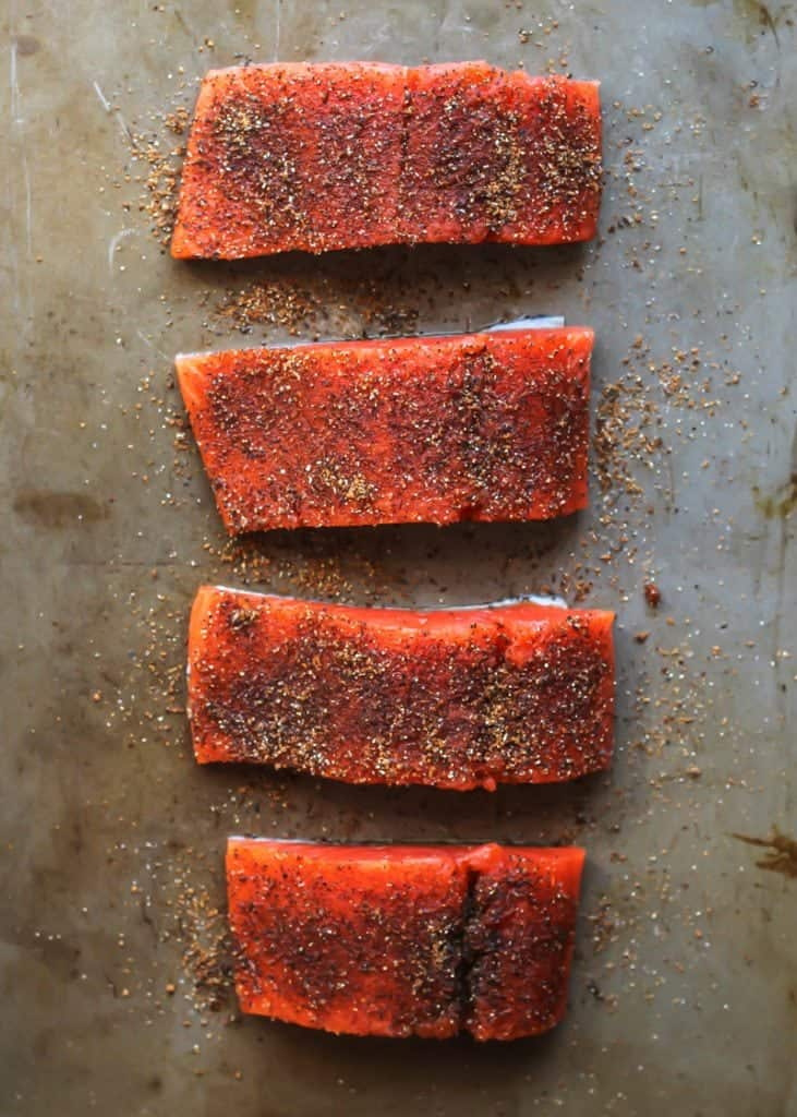 Sweet & Spicy Glazed Salmon raw and cut on baking sheet