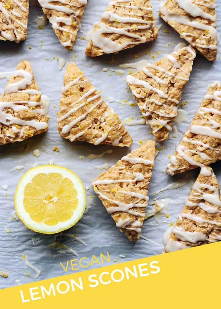 Vegan Lemon Scones with half a lemon on baking sheet with parchment paper