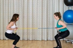 5 Minute Buddy Band Workout - Squat Banded Rows