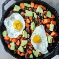 breakfast skillet with chorizo, sweet potatoes, avocado and fried egg