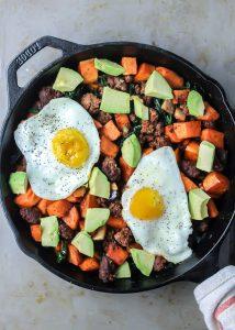 breakfast skillet with chorizo, sweet potatoes, avocado and fried egg