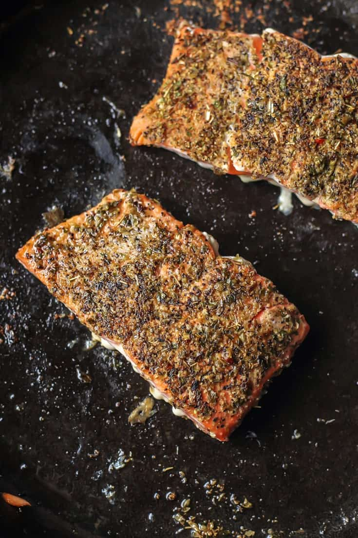 seasoned salmon on skillet