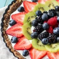 A healthy dessert great for all ages! Greek Yogurt Fruit Tart with a superfood crust!