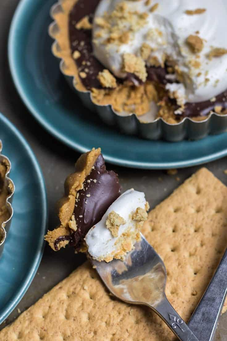 No-Bake Peanut Butter Cup S'MORES TARTS. Yes, it is a thing. These are so fun! Made dairy-free and gluten-free friendly. They're such a fun dessert.