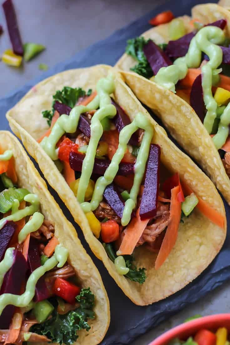 Spicy Beet BBQ Pork Tacos with avocado sauce