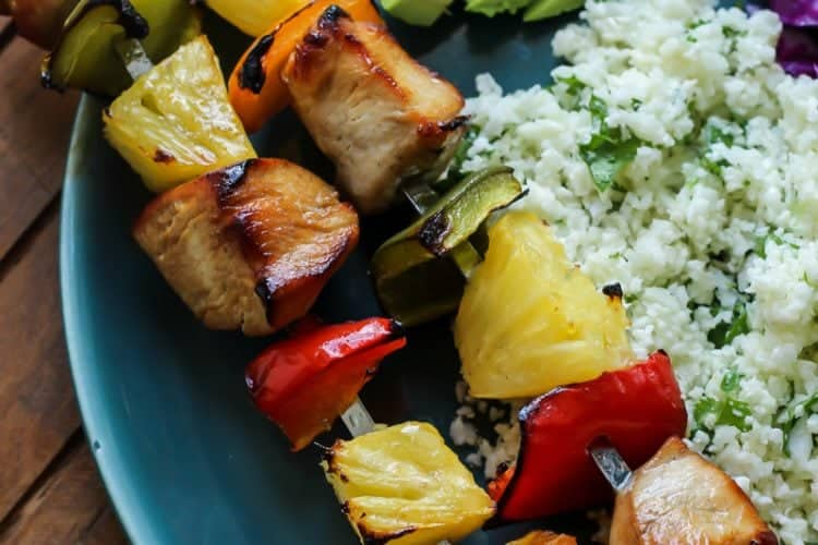 Easy Citrus Herb Chicken Kabobs with Cilantro Lime Cauliflower Rice with avocado on teal plate