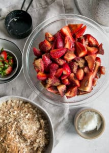 strawberries covered in sugar in bowl