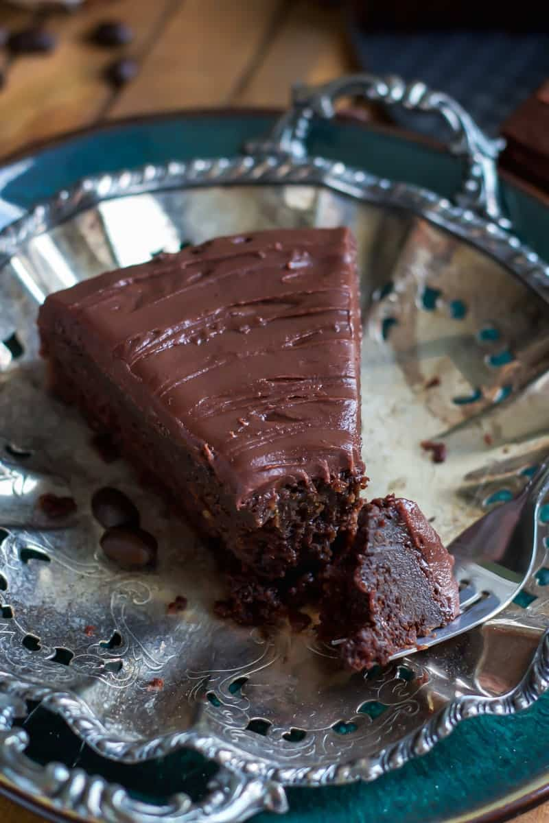 slice of chocolate fudge mocha cake on silver platter with piece of cake on fork