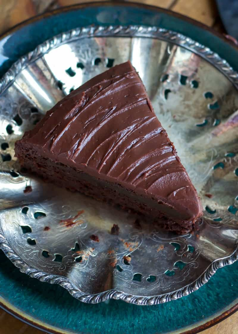 Slice of Greek Yogurt Chocolate Cake with Mocha Fudge Frosting on silver and teal plate