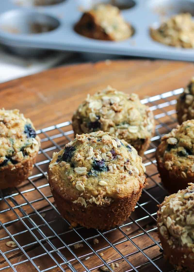 These Whole Grain Blueberry Muffins are so soft and fluffy! Made with whole grain flour, sweetened with maple syrup and made dairy-free. Vegan-friendly too!
