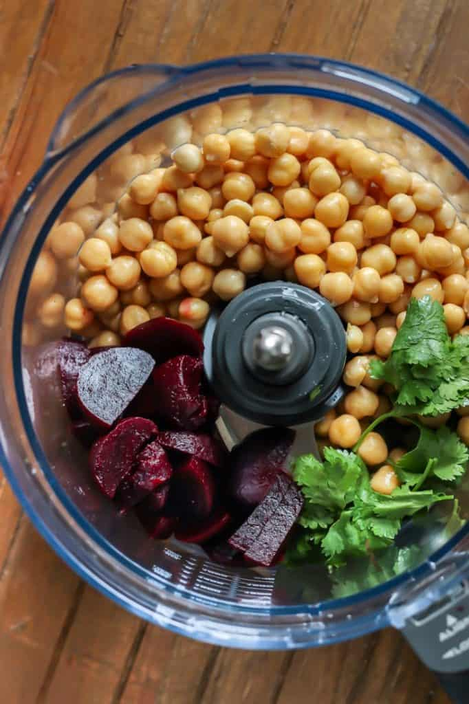 Beets, chickpeas, and cilantro in a food processor