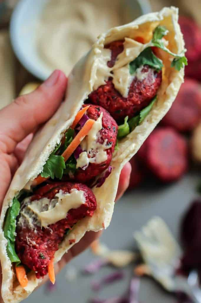 Beet falafel pita with a bite