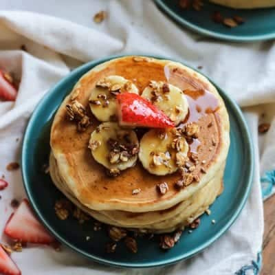These Whole Grain Greek Yogurt Pancakes are easy, simple and just what your weekend needs! Make a big batch to freeze and you can enjoy pancakes all week long.