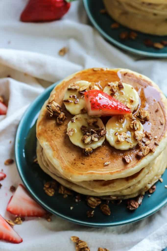 Whole grain greek yogurt pancakes on a blue plate