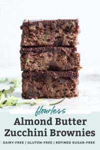 stack of three paleo zucchini brownies with shredded zucchini and text overlay