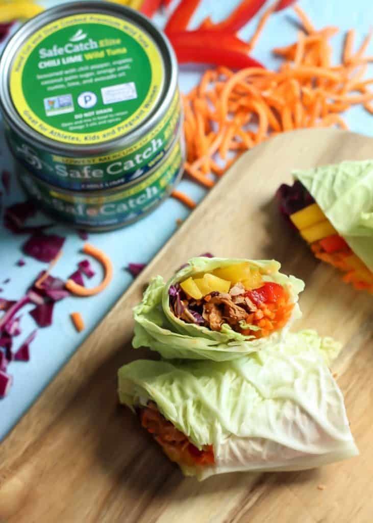 easy chili lime cabbage wraps with carrots and peppers on cutting board