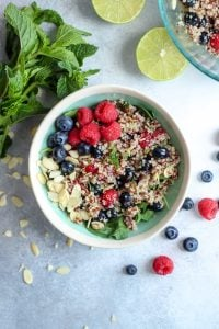 berry quinoa salad with mint and almonds in bowl